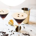 two espresso martinis garnished with three coffee beans each