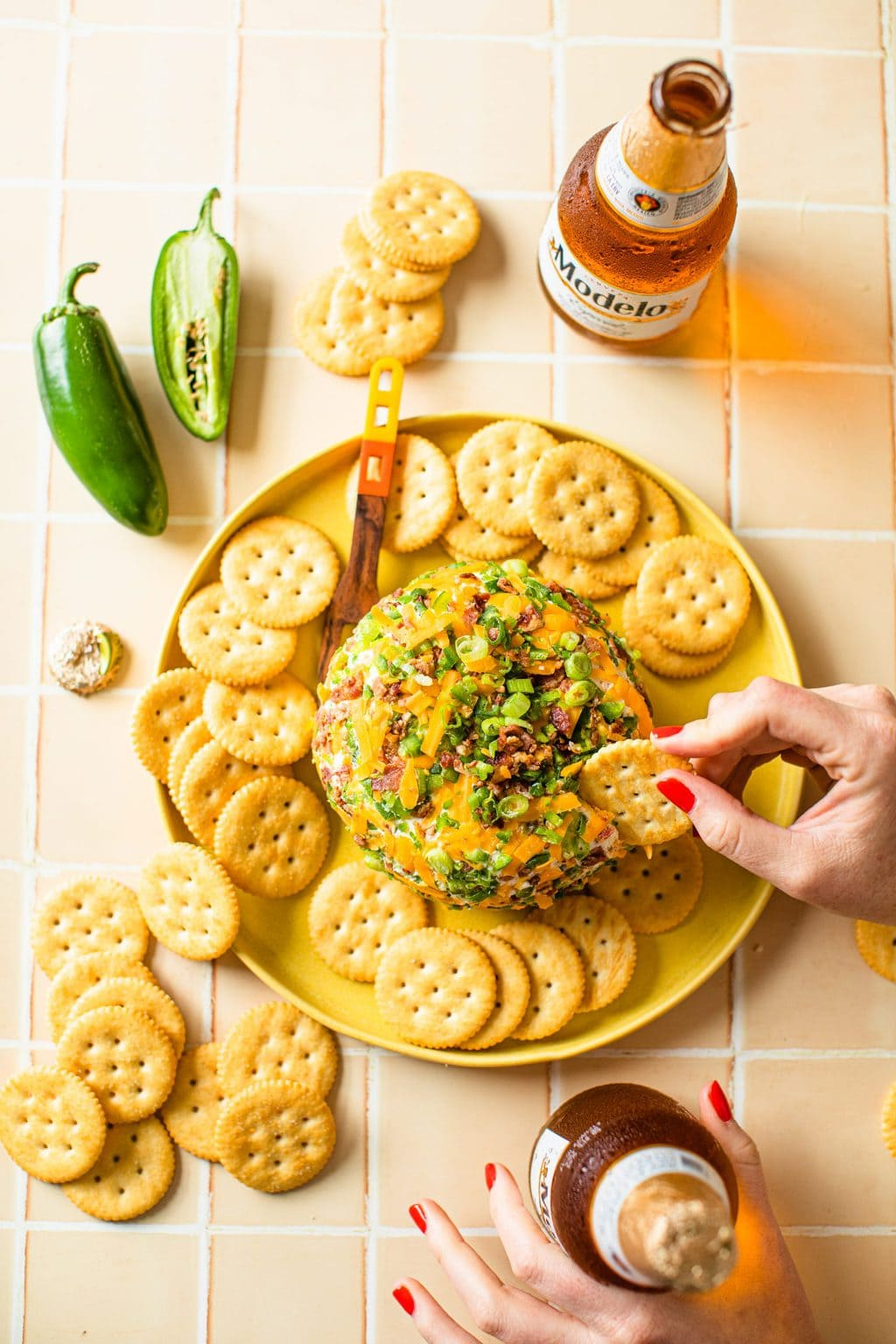 hand dipped in large cheddar cheese ball with crackers