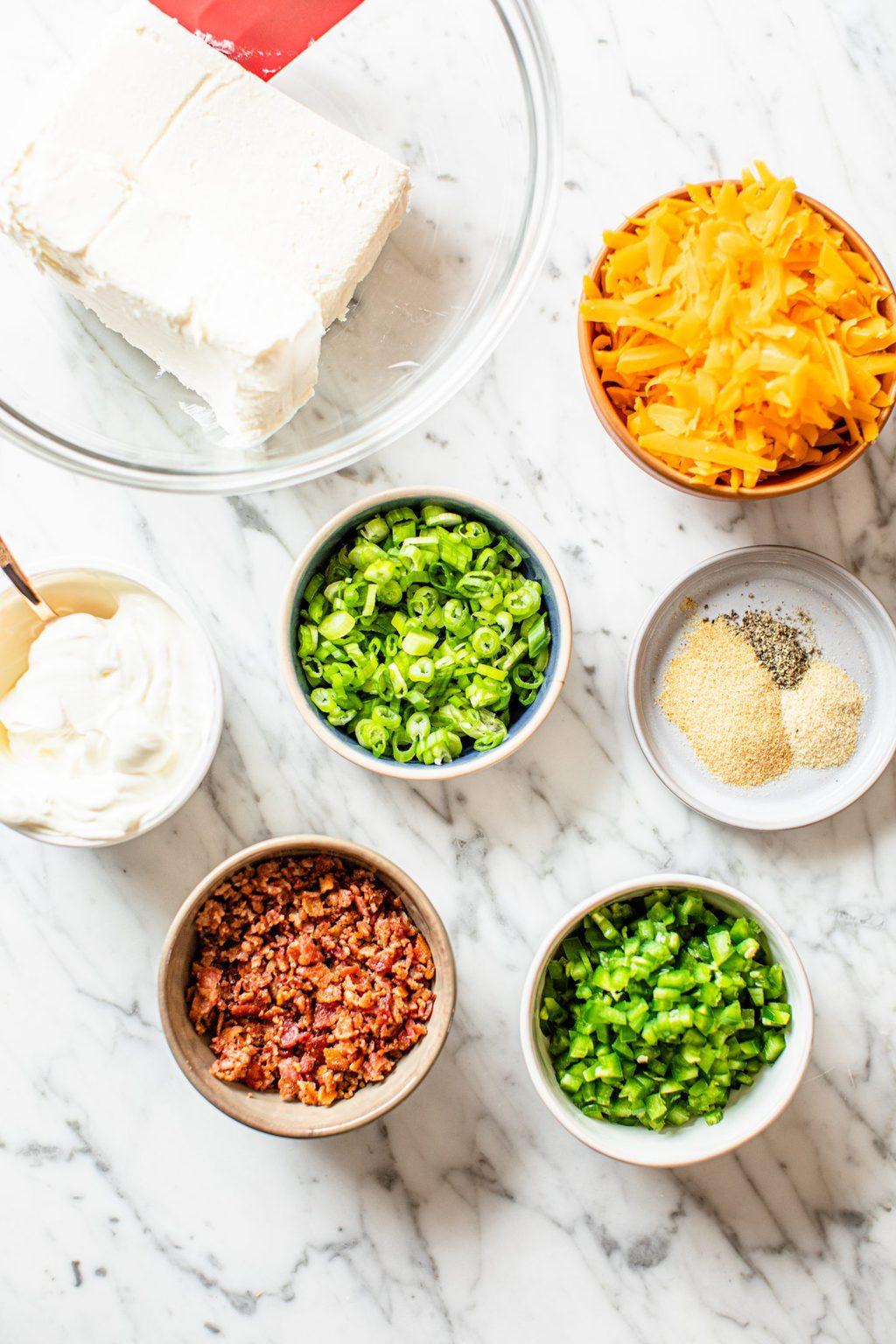 cream cheese, shredded cheddar, sour cream, scallions, seasonings, bacon, jalapenos
