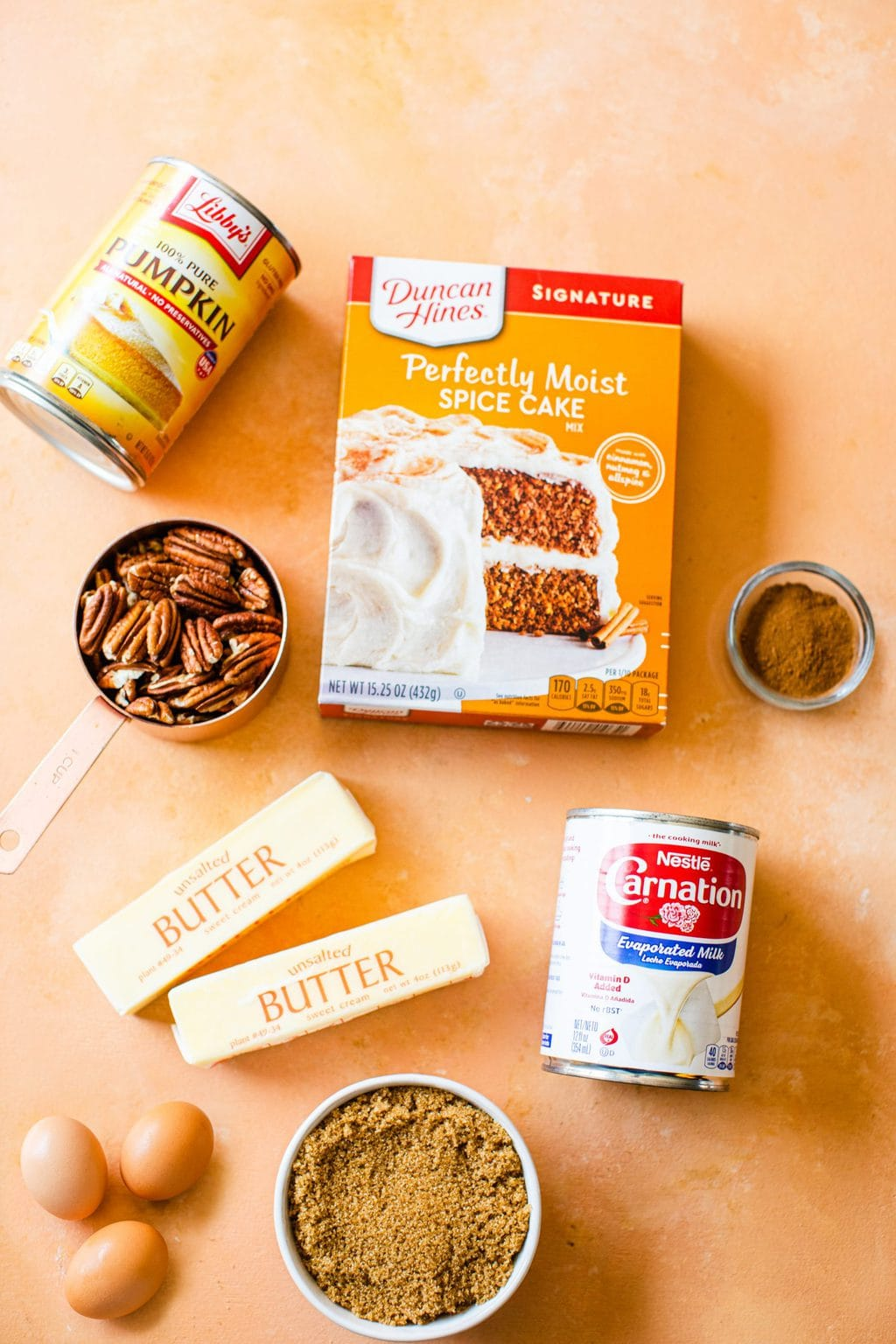 pumpkin puree, pecans, butter, eggs, brown sugar, spice cake mix, evaporated milk, pumpkin pie spice