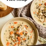 creamy chicken and rice soup in a soup bowl with spoon